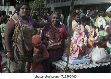 VADODARA, GUJARAT / INDIA - SEPTEMBER 5, 2017 : TWO WOMEN WITH THE STATURE OF A LORD SHREE GANESHA DURING THE GANESHA FESTIVAL.