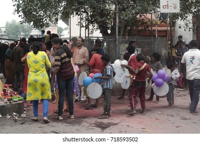 VADODARA, GUJARAT / INDIA - SEPTEMBER 5, 2017 : CHILDREN ARE PLAYING THE DHOL A MUSICAL INSTRUMENT DURING THE GANESHA FESTIVAL.