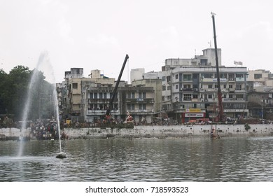 VADODARA, GUJARAT / INDIA - SEPTEMBER 5, 2017 : A WIDE ANGLE VIEW OF A LAKE AND THE PEOPLE SURROUNDED TO IT TO SUBMERGE THE STATUE OF A LORD GANESHA DURING THE GANESHA FESTIVAL.