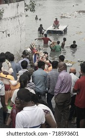 VADODARA, GUJARAT / INDIA - SEPTEMBER 5, 2017 : A GROUP OF PEOPLE ARE TAKING THE STATUE TO THE LAKE WATER TO SUBMERGE IT INTO DURING THE GANESHA FESTIVAL.