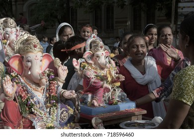 VADODARA, GUJARAT / INDIA - SEPTEMBER 5, 2017 : A GROUP OF WOMAN WITH THE STATUE OF A LORD SHREE GANESHA.