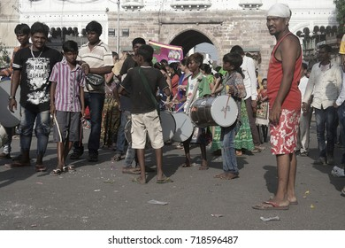 VADODARA, GUJARAT / INDIA - SEPTEMBER 5, 2017 : A GROUP OF YOUNG BOYS ARE DANCING AND PLAYING A MUSICAL INSTRUMENT DURING THE GANESHA FESTIVAL.