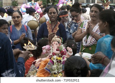 VADODARA, GUJARAT / INDIA - SEPTEMBER 5, 2017 : A GROUP OF WOMEN ARE PRAYING THE RITUALS TO THE LORD SHREE GANESHA DURING THE GANESHA FESTIVAL.