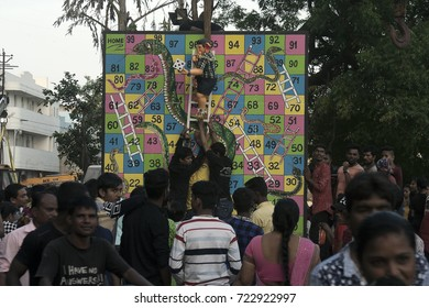 VADODARA, GUJARAT / INDIA - SEPTEMBER 5, 2017 : THE STATUE OF A LORD SHREE GANESHA AS A YOUNG BOY ON LADER WITH DICE ON HAND DURING THE GANESHA FESTIVAL