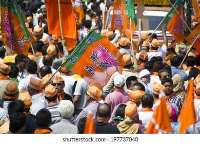 VADODARA, GUJARAT/INDIA - 9 April 2014 : Large crowd waiting for Gujarat Chief Minister and BJP prime ministerial candidate Narendra Modi to arrive on 9th april in Vadodara, Gujarat.
