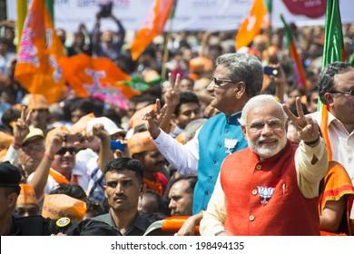 VADODARA, GUJARAT/INDIA - 9 April 2014 :Gujarat Chief Minister and BJP prime ministerial candidate Narendra Modi showing victory sign on 9th april in Vadodara, Gujarat.