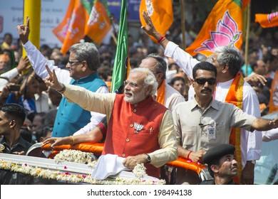 VADODARA, GUJARAT/INDIA - 9 April 2014 : Gujarat Chief Minister and BJP prime ministerial candidate Narendra Modi waving hands to the crowd on 9th april in Vadodara, Gujarat.