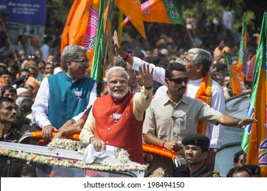 VADODARA, GUJARAT/INDIA - 9 April 2014 : Gujarat Chief Minister and BJP prime ministerial candidate Narendra Modi showing happy gestures with hands on 9th april in Vadodara, Gujarat.