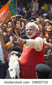 VADODARA, GUJARAT/INDIA - 9 April 2014 :  Gujarat Chief Minister and BJP prime ministerial candidate Narendra Modi shows victory sign to people on 9th april in Vadodara, Gujarat.