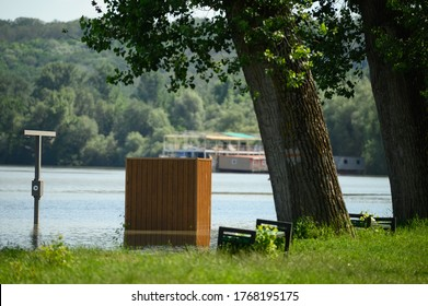 Vadul lui Voda, Criuleni, Moldova, June 2020: Flood caused by Dniester river spill after heavy rains set in Vadul lui Voda beach area. Flooded beach cabin, shower and bench