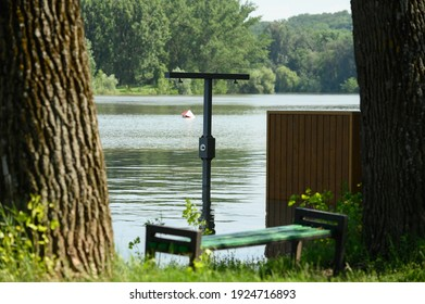 Vadul lui Voda, Criuleni, Moldova, June 2020: Flood caused by river spill after heavy rains set in Vadul lui Voda beach area. Flooded beach cabin, shower and bench - Shutterstock ID 1924716893