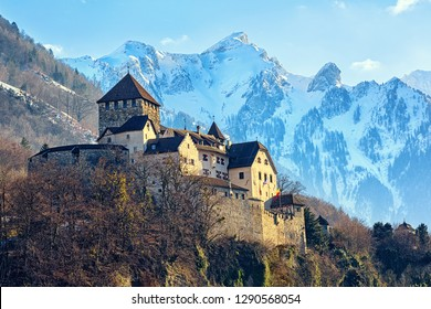 Vaduz Castle, Liechtenstein, winter view with snow covered Alps mountains in background