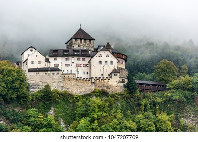 The Vaduz Castle under the foggy mountain in Liechtenstein.
