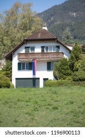 Vaduz, Liechtenstein, 16th August 2018:- A house in Vaduz, capital of Liechtenstein flying the national flag