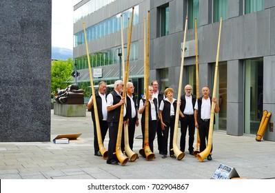 VADUZ, LIECHTENSTEIN -17 AUG 2017- Musicians playing Alphorn, a traditional musical  instrument in the Swiss Alps, on the street in Vaduz, Principality of Liechtenstein.