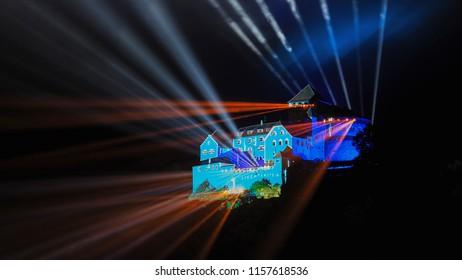 VADUZ, LIECHTENSTEIN - AUGUST 14, 2018: Beautifully illuminated castle Vaduz at night. Final test of the impressive 3D video mapping show for Liechtenstein's national holiday.