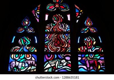 VADUZ, LIECHTENSTEIN - JULY 13, 2018: Stained glass window in Cathedral of St. Florian in Vaduz, Liechtenstein