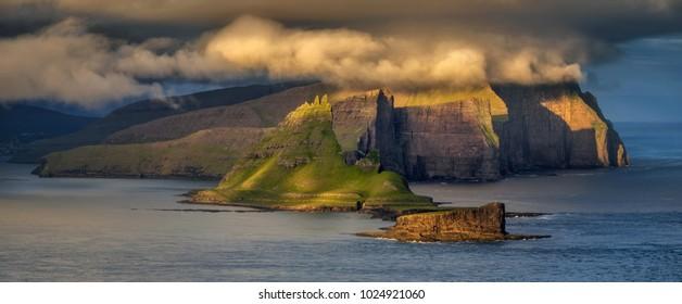Vagar and Tindholmur islands in sunset, Faroe Islands