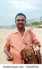 VAGATOR, GOA, INDIA - MARCH 14: Local Indian man sell souvenirs on the beach, March 14, 2013 in Vagator Goa, India. This activity will provide a income stream  for people on this Indian state