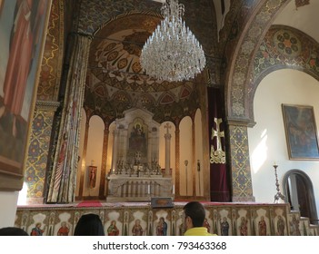 VAGHARSHAPAT, ARMENIA - SEPTEMBER 17, 2017: Inside one of the oldest  Etchmiadzin Cathedrals in the world. It has unique architectural style and design. Altar with chandelier