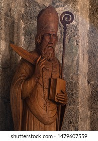 VAGLI SOTTO, LUCCA, ITALY AUGUST 9, 2019: Old carved statue of St Augustine to whom the small church in Vagli Sotto is dedicated. The building dates back to the 11th century.