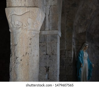 VAGLI SOTTO, LUCCA, ITALY AUGUST 9, 2019: An ancient pillar carving in the small church of St Augustine which dates back to the 11th century.