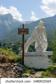 VAGLI SOTTO, LUCCA, ITALY AUGUST 8, 2019: A white marble statue of Francesco Schettino with rabbit ears situated in the park of honour and dishonour near Vagli Lake.