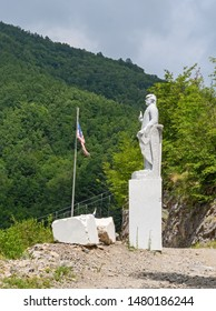 VAGLI SOTTO, LUCCA, ITALY - AUGUST 8, 2019: A marble statue of US President Donald Trump in the Park of Honour and Dishonour near Vagli Lake, Garfagnana.