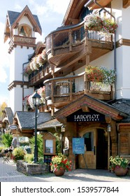 VAIL, COLORADO - CIRCA 2015: Lancelot Restaurant with curving wooden balconies, lamp post, and tower