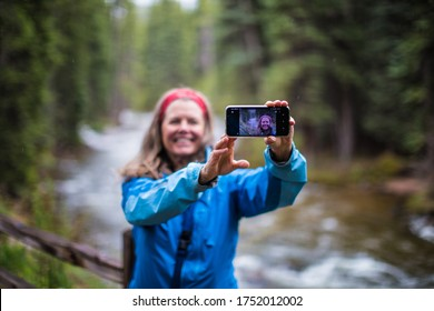 Vail, Colorado- May 24 2020: A happy woman taking a selfie photo of her self in Vail, Colorado, USA