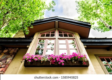 Vail European Swiss style resort town house home building window exterior with flower decorations in Colorado low angle view