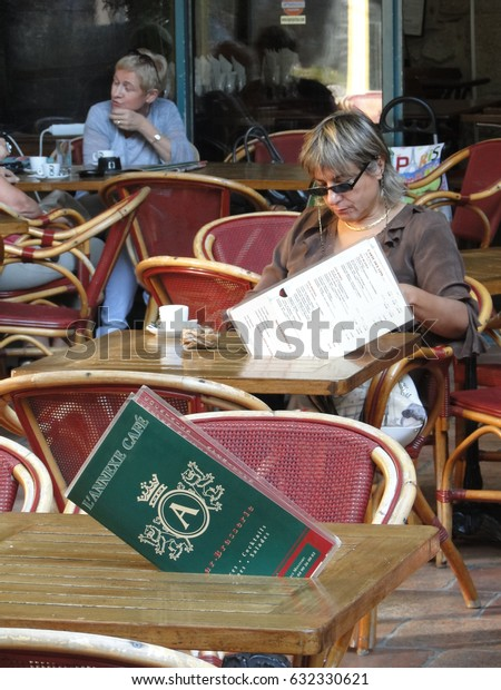 VAISON LA ROMAINE, FRANCE - SEP 27 - Morning customers order their coffee   in a cafe  on Sep 27, 2011 in Vaison la Romaine, France.