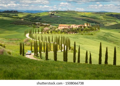 VAL D ORCIA, TUSCANY - MAY 04, 2019: Beautiful cypress-lined road in the light of the setting sun