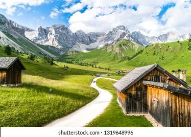 Val di fassa during summer season. Fuciade chalet during summer and panorama of dolomites (trentino alto adige)