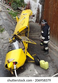 VAL DI FUNES, ITALY - October 13, 2012: The cockpit of a yellow small light aircraft Cessa crashed in the centre of a mountain town. Airplane crash on October 13, 2013 in Va di Funes