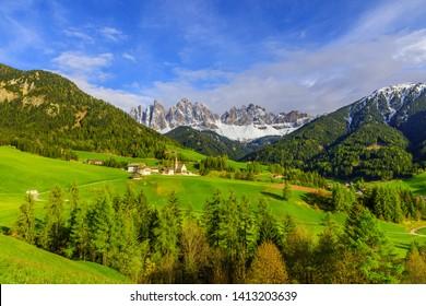 Val di Funes valley, Santa Maddalena touristic village, Dolomites, Italy, Europe in a sunny day