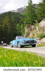 VAL DI POSCHIAVO, SWITZERLAND - JUNE 13: A blue Mercedes 190 SL takes part to the Summer Marathon classic car race on June 13, 2014 in Val di Poschiavo. This car was built in 1961