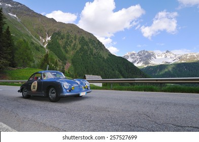 VAL DI POSCHIAVO, SWITZERLAND - JUNE 13: A blue Porsche 356 A T1 takes part to the Summer Marathon classic car race on June 13, 2014 in Val di Poschiavo. This car was built in 1956