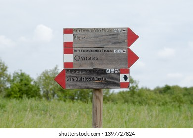 Val d'Orcia landscape in spring. Signs of the Val d'Orcia trekking routes. Val d'Orcia, Siena, Tuscany, Italy - May, 2019.