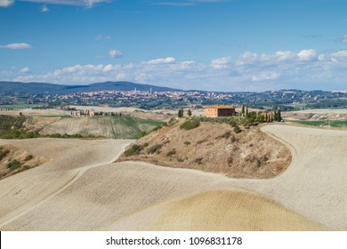 Val d'Orcia, October 2017:Tuscan landscape with hill, house and cypress, on March 2017 in Val d'Orcia, Siena, Tuscany, Italy