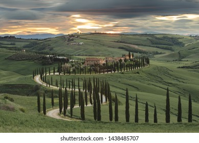 Val d'Orcia, Tuscany, Italy - May 14, 2019: Italian countryside in spring at sunset.
