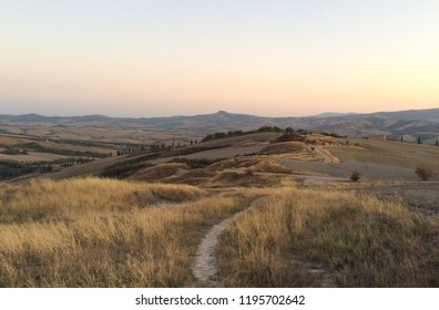 Val d'Orcia, Tuscany, Italy - September 13, 2017: Beautiful Val d'Orcia suffered extremely dry summer of 2017 that turned landscapes from green to golden
