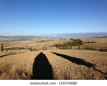 Val d'Orcia, Tuscany, Italy - September 14, 2017: Beautiful Val d'Orcia suffered extremely dry summer of 2017 that turned landscapes from green to golden
