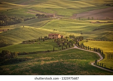Val d'Orcia, Tuscany/Italy - May 10 2016: Landscape in the hills of Val d'Orcia. Sunny afternoon in Tuscany