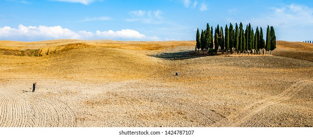 Val D'Orcia,Tuscany,Italy 12 august 2010:Photographing in front of cypress trees in the Val D'Orcia