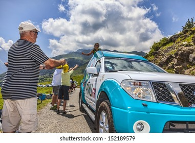 VAL LOURON, FRANCE - JUL 7:Spectators while a PMU.fr truck is passing on the road to Col de Val Louron Azet during the stage 9 of the 100 edition of Le Tour de France  on July 7 2013