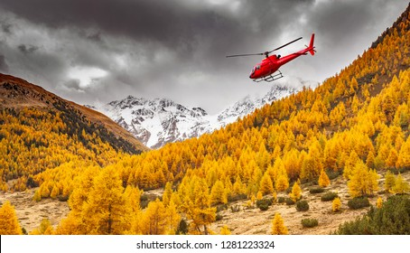 Val Nera - Livigno (IT) - red helicopter in flight