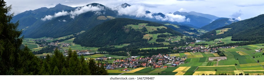 Val Pusteria seen from above with the villages of Rasun, Valdaora di Centro and Valdaora di Sopra as seen from the road towards Passo Furcia. South Tyrol in Italy