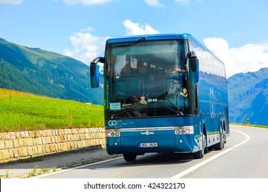 VALAIS, SWITZERLAND - AUGUST 5, 2014: Coach bus Van Hool T916 Acron at the high mountain Alpine road.