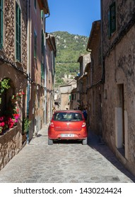 Valdemossa, Spain - 30.05.2019: Car on a narrow medieval street